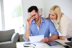 Couple having trouble with invoice Stock Image