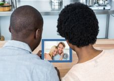 Couple having video call with friends on digital tablet Royalty Free Stock Photo