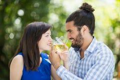 Couple having wine in a restaurant stock photo