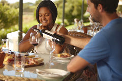 Couple having wine at winery restaurant Royalty Free Stock Photography