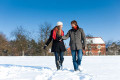 Couple having a winter walk Stock Photo