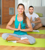 Couple having yoga class Royalty Free Stock Photo