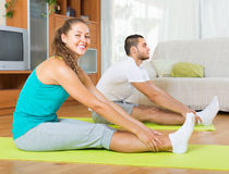 Couple having yoga class Royalty Free Stock Photo