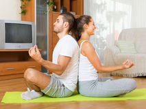 Couple having yoga class Stock Photography