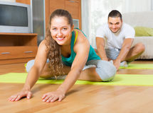 Couple having yoga class Royalty Free Stock Photography