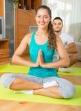 Couple having yoga class Royalty Free Stock Photos