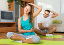 Couple having yoga class Royalty Free Stock Image