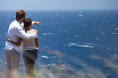Couple in Hawaii over lookig ocean Stock Photos