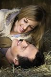 Couple in hay. Royalty Free Stock Photography