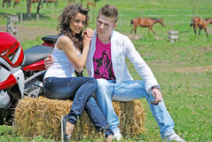 Couple on a hay bale Royalty Free Stock Images