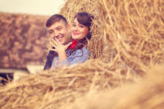 Couple on a hay bale Royalty Free Stock Photo