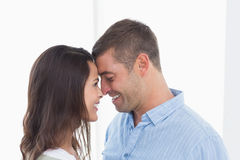 Couple with head to head at home Stock Photo