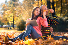 Couple With Headphones Enjoying Music In Autumn stock images