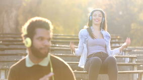 Couple with headphones listening to music and dancing to the rhythm stock video footage