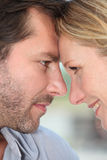 Couple with heads together Royalty Free Stock Images