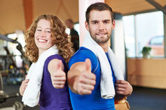 Couple in health club holding Stock Image