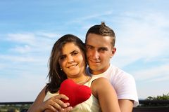 Couple with heart. Beautiful couple hugging, showing love - outdoor Stock Image