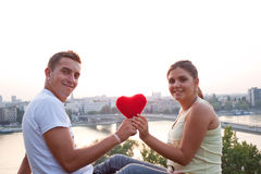 Couple with heart. Lovely couple holding a heart Royalty Free Stock Photos