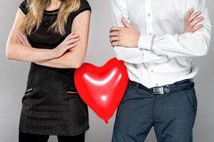Couple with heart balloon between them Stock Photos