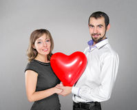 Couple with heart balloon between them Stock Photo