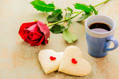 Couple of heart shape white bread with coffee cup and red rose. Royalty Free Stock Photography