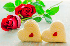Couple of heart shape white bread and red rose. Royalty Free Stock Images