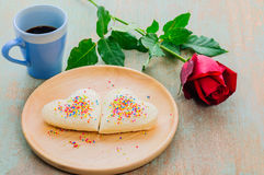 Couple of heart shape white bread on wooden plate with coffee cup and red rose Royalty Free Stock Photo