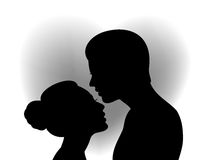 Couple with heart shaped background Royalty Free Stock Images