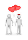 Couple with heart shaped balloons Royalty Free Stock Photography
