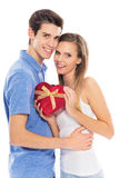 Couple with heart-shaped box Royalty Free Stock Image
