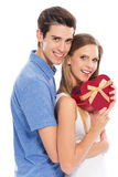 Couple with heart-shaped box Royalty Free Stock Images