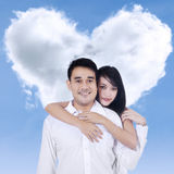 Couple and heart shaped cloud Royalty Free Stock Images
