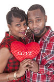 Couple with a heart shaped sign Royalty Free Stock Images