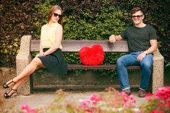 Couple with heart sitting in park Stock Photography