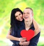 Couple with heart smiling outdoors Stock Image