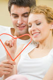 Couple with heart symbol Stock Photography