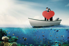 Couple with heart symbol on boat Royalty Free Stock Photography