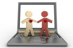 Couple with heart on their chest on laptop Royalty Free Stock Photography