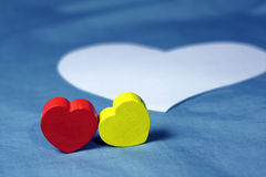 Couple Hearts. Pair of hearts in colorfully painted wood Royalty Free Stock Images