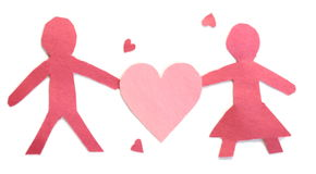 Couple and Hearts. Two people and hearts made of red and pink construction paper for Valentine's Day Stock Images
