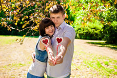 Couple with hearts Stock Image