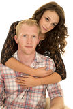 Couple her behind arms around chest smile Royalty Free Stock Images