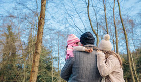Couple with her little daughter enjoying of forest Royalty Free Stock Photography