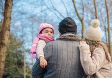 Couple with her little daughter enjoying of forest Royalty Free Stock Images