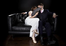 Couple Hiding Behind a Fan for Privacy Stock Image