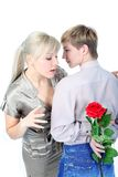 Couple with hiding flower Stock Photography