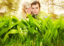 Couple hiding in a grass Royalty Free Stock Photo