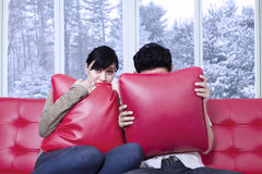 Couple hiding on the pillows Royalty Free Stock Photos