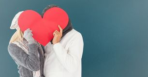 Couple hiding their face with red heart