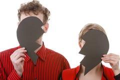 Couple hiding their faces. Royalty Free Stock Photo